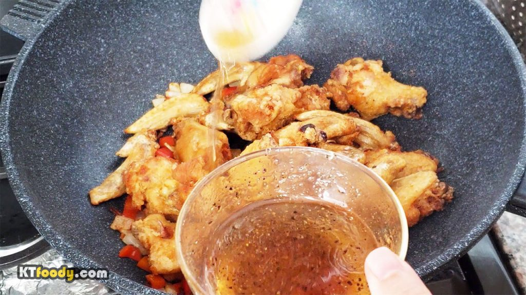 Fish sauce wings recipe pouring sauce on wings