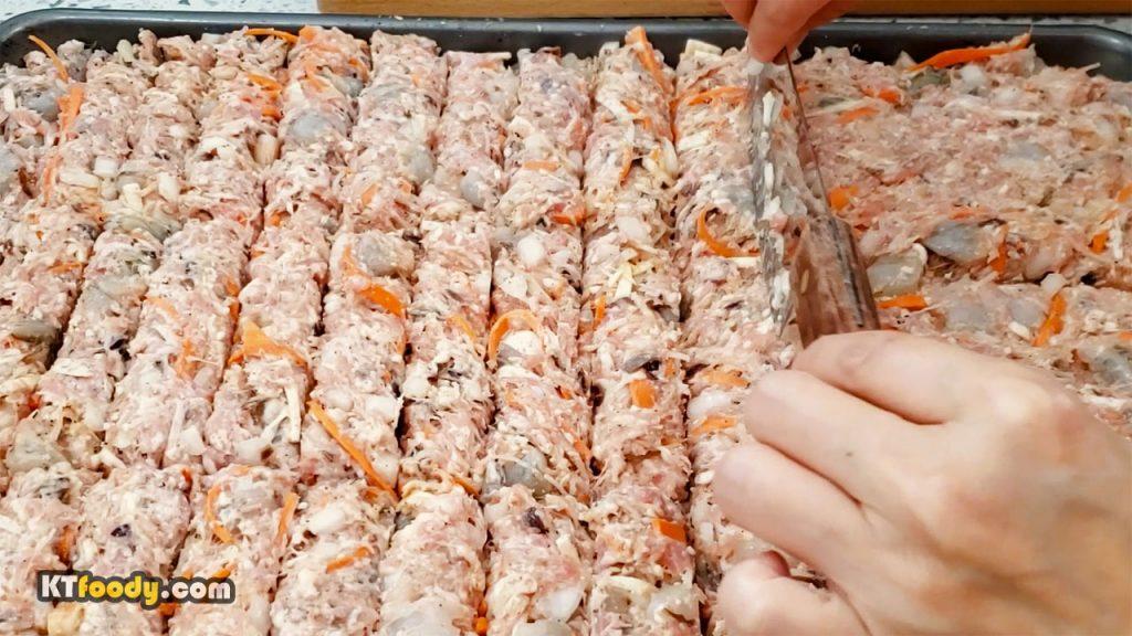 Spread egg roll filings on rectangular pan