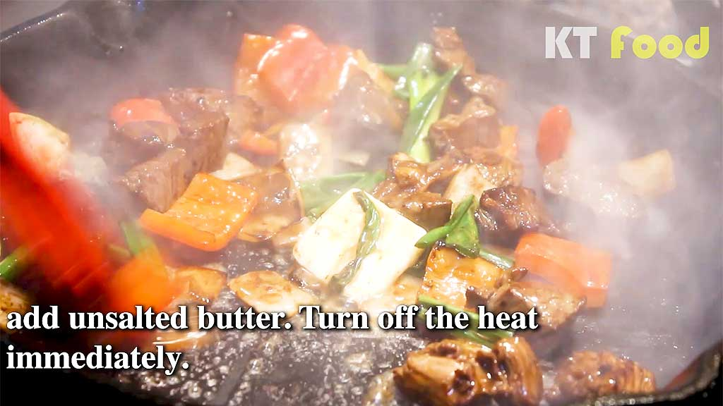 Shaking Beef stir frying and adding butter
